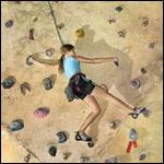 child climbing rock wall
